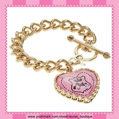 "Juicy Couture Pink Heart Charm Toggle Bracelet HPNWT Juicy Couture Viva La Couture pink heart reversible charm gold tone bracelet will be a chic addition to your JC jewelry wardrobe! The bracelet features: toggle closure, large reversible heart charm with one side engraved ""J"" means Viva La Couture & the opposite side has a pink scottie dog crest.   *Bracelet 7 1/4"" length *Charm 1 1/4"" X 5/16"" thick *Bundle Discounts, Smoke-Free, No Trades Juicy Couture Jewelry Bracelets"