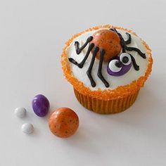 Easy Halloween recipes: Mr. Spider Cupcakes with a colorful malted-milk ball for body and an almond M&M for head