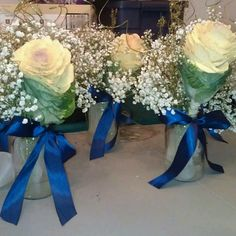 Flowers, Engagement party, wedding centerpieces, baby's breathe (2 sizes) with cabbage flower glitter green twirls/twigs and dried glitter flowers, navy blue satin ribbon, mason jars 32oz with ivory glitter mesh, made myself...DIY - THESE ARE MINE!!! <3