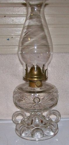 Findlay Ohio Glass Eyewinker Two Handle Finger Oil Lamp