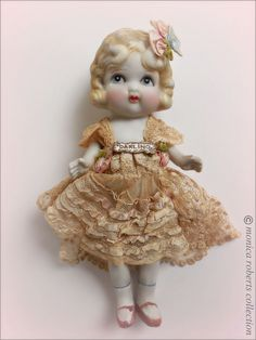 my little bisque carnival girl ... ca. 1920s Looks kind of what I remember mom's looking like but without the dress.
