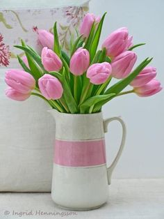 Pink tulips arranged in a lovely pitcher 'vase'...