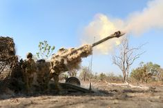 Australian soldiers fire a M-777 Howitzer in support of US Marines, August 11, 2016 at Bradshaw Field Training Area, Northern Territory, Australia.
