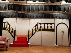 "Warbucks' Mansion set for Annie Jr. Middle School Production ... there was a curtain hanging above the stairs for a ""window""."