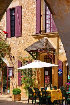 I will dine at a sidewalk cafe in Monpazier, France