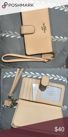 Coach Wallet Wristlet! NWOT Coach wristlets with a spot to fit phone! It's a peachish nude color and fits an i phone 6,7 etc. Coach Bags Clutches & Wristlets