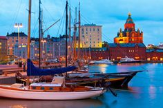 Classic boats with Uspenski Cathedral in background.#Helsinki #ScanAdventures