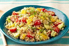 This Greek quinoa salad isn't just tasty—it's good-looking, too, with halved cherry tomatoes, yellow peppers, and shreds of chopped fresh dill.