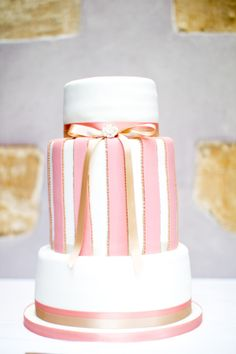 white, pink and gold wedding cake - from Oxford cake designer sweet on cake. #gold #pink #weddingcake  http://www.weddingchicks.com/2013/12/09/elegant-english-wedding/