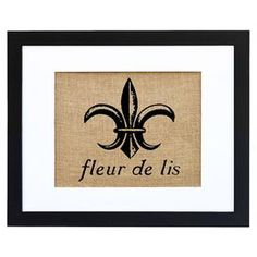 """Equally at home in an artful collage or on its own as an eye-catching focal point, this hand-pressed burlap print showcases a charming fleur-de-lis motif for a touch of French-inspired charm. Made in the USA.  Product: Framed printConstruction Material: Engineered wood, paper and burlapColor: Black and brown frame  Features: Hand-pressedMade in the USAArrives ready to hangMade by Fiber and Water  Dimensions: Print: 8"""" H x 10"""" WFrame: 11"""" H x 14"""" W Overall: 12.62"""" H x 15.67"""" W ..."""