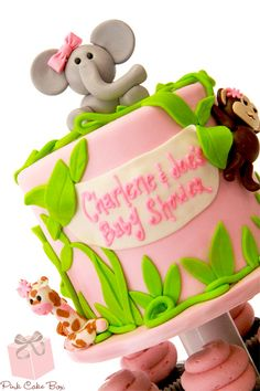 Jungle Girl Baby Shower Cupcake Tower by Pink Cake Box in Denville, NJ. More photos and videos at http://blog.pinkcakebox.com/jungle-girl-baby-shower-cupcake-tower-2013-02-20.htm