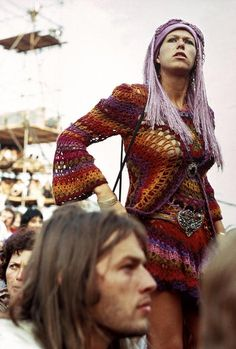 Guitarist and songwriter David Gilmour, most famously of the British rock band Pink Floyd, is caught in the foreground of an image taken at a pop festival on the Isle of Wight, England, United Kingdom, 1969, photograph by David Hurn.