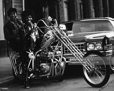 Singer Sly Stone and guitarist Freddie Stone of the psychedelic soul group 'Sly and the Family Stone' ride a chopper on April 3, 1973 in San Francisco, California.