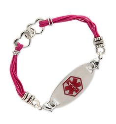 Fuchsia makes everything more fun! Our Together Forever Medical ID Bracelet is perfect anyone who is looking to add a little fun to her wrist. This unique style features 2 stainless steel intertwined hearts and is finished off with multiple strands of fuchsia suede accented by stainless steel rings. #laurenshopeID #medicalID $39.95