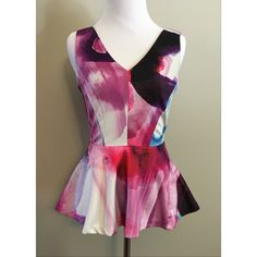 H&M watercolor peplum blouse–XS H&M peplum blouse with white water color design. Hues of pink, purple, and blue. Size XS. Extremely flattering silhouette. V-neck front and deeper v-neck back with zipper detail. 94% polyester, 6% elastane (gives it a tiny bit of stretch). Machine wash cold on gentle; line dry, medium iron if necessary. H&M Tops Blouses