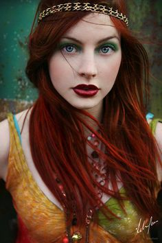 deep red hair and green eyeshadow. <3