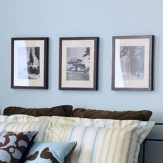 Paint an Accent Wall    Establish the room's restful tone with a serene hue around the bed. Then, relive favorite trips by elevating vacation photos to art with a trio of classic, gallery-style frames.
