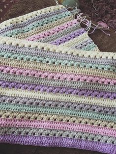 Best 12 Rainbow Baby Blanket Make a beautiful unisex cot blanket in pastel rainbow colours. Easy and fast to crochet – the perfect gift for a baby shower or new arrival. Granny Square Crochet Pattern, Crochet Flower Patterns, Afghan Crochet Patterns, Crochet Squares, Crochet Motif, Crochet Hooks, Crochet Designs, Easy Crochet, Crochet Stitches
