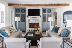 "Marie Flanigan Interiors - Benjamin Moore ""Going to the Chapel"" - Benjamin Moore ""Puritan Gray"" cabinets - Wood Beams - Living Room - Circa Lighting Baluster Table Lamp - Shalom Brothers Oushak Rug - John Brooks Sofa"