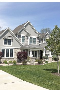 Shingle style custom home exterior with grey Mastic vinyl shake and custom color Hardie board and batten. House Siding, House Paint Exterior, Dream House Exterior, Exterior Siding, Exterior Remodel, Exterior House Colors, Exterior Design, Hardie Board Siding, Stone Exterior