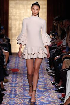 Brandon Maxwell Spring 2017 Ready-to-Wear: Adorable, fun, and youthful mini dress with layered ruffles on the hem and the sleeves.