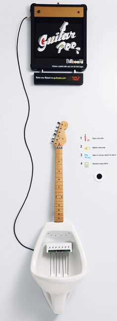 """Can you """"play"""" this guitar urinal"""