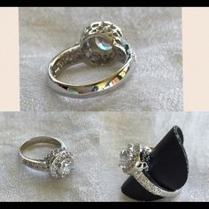 'Oh So Glam' ring. Size 7. Premier Designs Rhodium plated. Cubic zirconia stones. High quality. Intricate detailing with smaller stones surrounding center stone and along sided of band. Never worn. Premier Design Quality. Premier Designs Jewelry Rings