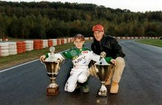 German Formula 1 drivers Sebastian Vettel, current 4 time world champion, and his idol, Michael Schumacher, seven-time world champion. Vettel was 12.