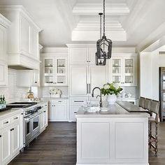 White Raised Panel Kitchen Cabinets with White Mini Subway Tile Backsplash