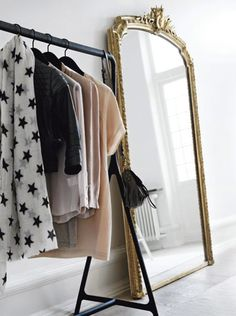 I like the idea of placing a rack in the bedroom. I could hang my outfits for the whole week.