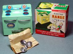 In terrific old stock condition, this tin electric stove was made in Japan for Linemar. About 4 inches by 4 Inches with great lithography. Includes the pots and pans in their original paper packaging!