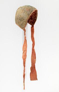 Child's cap, Norway, 1720-1740. Silk brocade, edged with orange silk, block printed cotton lining, orange silk ribbon binding.