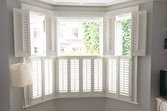 Cafe shutters are perfect for Bay Windows - light control and privacy ! Cafe Shutters, White Shutters, Interior Window Shutters, Interior Windows, Bay Window Blinds, Bedroom Shutters, Shutter Blinds, Bay Windows, Bay Window Living Room