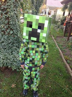 DIY Minecraft Creeper Costume Gray sweatsuit with inch squares of green fabric ironed on, cardboard head from FYE Minecraft Creeper Halloween Costume, Creeper Costume, Minecraft Costumes, Boy Halloween Costumes, Boy Costumes, Halloween Party Decor, Halloween 2019, Holidays Halloween, Fall Halloween