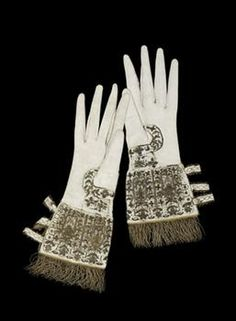 Ceremonial Gloves worn by Elizabeth I in 1566, which she reportedly pulled on & off repeatedly to show off her hands!