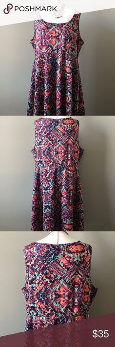 """Torrid dress multicolor Women plus Size 3 3x Necklace not included *** Preowned in like new condition torrid skater dress women plus size 3 (3x.) sleeveless multicolor skater style dress. Knee length dress. Beautiful dress .  No snags, wear or stains  Smoke free/pet free Measurements are taken laid flat  Underarm to underarm 23"""" Underarm to bottom seam 30"""" Shoulder to shoulder 17"""" Waist 20"""" torrid Dresses"""