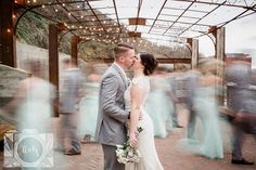 Bride, Groom, bridesmaid and groomsmen pictures at The Standard in downtown Knoxville by Amanda May Photos
