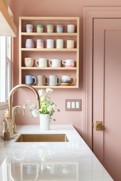 Beautiful remodeled kitchen with two tone cabinets, pastel pink walls, and brass fixtures. Pastel Kitchen Decor, Pastel Home Decor, Pastel Interior, Pink Kitchen Walls, Pink Kitchen Designs, Pink Kitchen Interior, Pink Kitchen Cabinets, Pastel Bathroom, Kitchen Wall Design