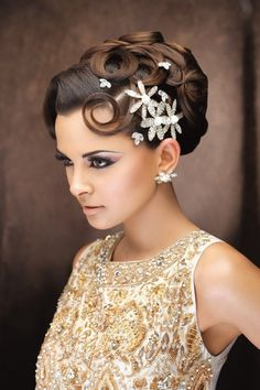 Sophisticated updo , classy updo, retro updo, wedding updo, very modern retro look