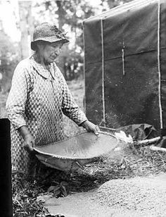 Ojibwe woman winnowing wild rice | The Ojibwe People's Dictionary