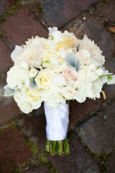 wedding bouquet with light pink, blue, yellow, and white