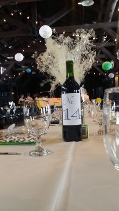 Adorable wine centerpieces on the tables at Happy Days Lodge