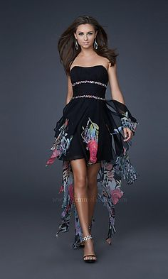 Amazing high low print chiffon dress with corset bodice and beaded waistband. The ruffle shredded skirt is short in the front and long in the back.
