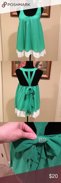 "LOVELY GREEN TUNIC 🍀 * Lush grass green glowing tunic * UA to UA 16"" * length 27"" from top of back collar to hem * 100 % polyester * material hangs beautifully * strappy back embellished with a bow accentuated with just enough bling to keep it classy🌹🌹 ** Bundle & save!! UmGee Tops Tunics"