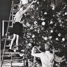 dosesofgrace: December! Princess Grace and Prince Albert trim their Christmas tree, by Howell Conant.