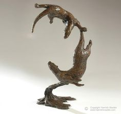 "I love otter sculptures- Hamish Mackie ""Otters playing underwater"""