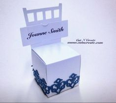 Chair favor boxes created in white with dark gray lace trim and escort cards.  Custom orders welcome! www.cutncreate.com http://facebook.com/CutnCreate