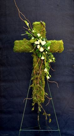 Bloomwoods Flowers and Events - Moss Cross with floral accent, $125.00 (http://www.bloomwoodsflowers.com/moss-cross-with-floral-accent/)