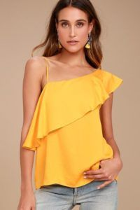 Step up your style game with the Chic Frills Yellow Satin One Shoulder Top! Soft satin fabric shapes this fun one shoulder blouse with a fluttering flounce and straight-cut bodice. Moda Zara, What Is Trending Now, What's Trending, Satin Top, One Shoulder Tops, Living At Home, Dressy Tops, Satin Fabric, Look Fashion