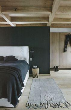 bedroom. half wall divider. grey color block. interior treatments. exposed wood beams.